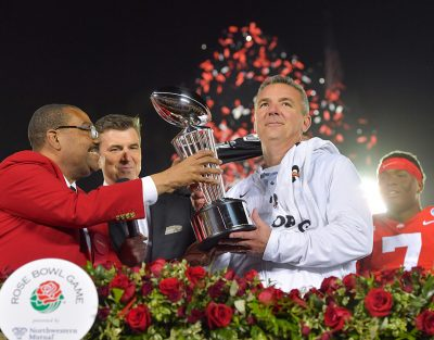 Urban Meyer receiving the Leishman Trophy